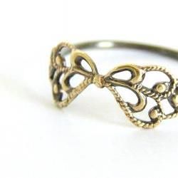 Delicate filigree ring. Sterling silver and vintage brass filigree bow.