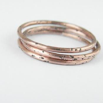 Minimalist copper stacking rings. Set of three simple bands.